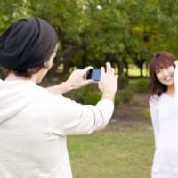 a portrait of young couple taking a photo